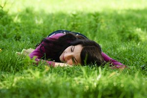 Girl take pleasure and rest on the grass
