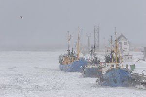 Ships fishermen in winter