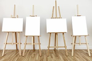 Four blank painting easels
