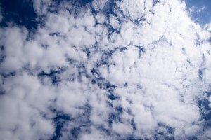 Cirrus and cumulus clouds. Heavenly