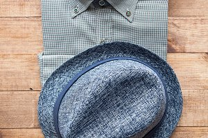 Hat and shirt on wooden