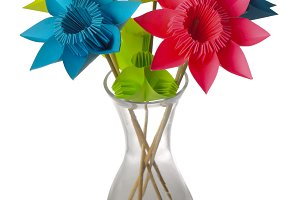 Origami flowers in glass vase