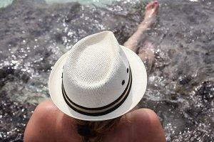Woman in Hat Sitting in Ocean