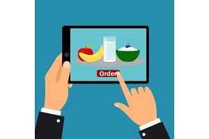 Hand holding tablet, order food