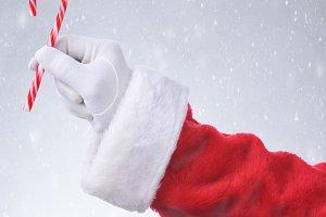 Santa Hanging Candy Cane Snowy Backg