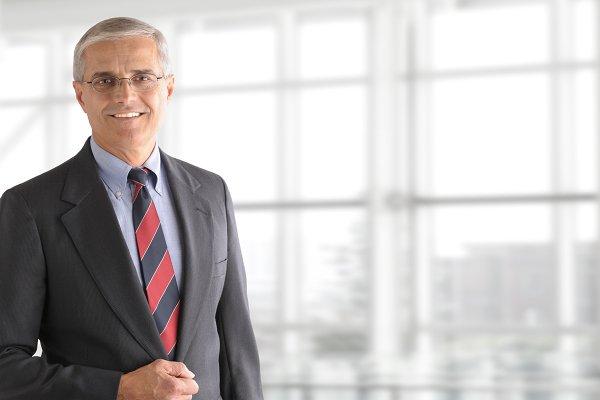 Mature Businessman Standing in Offi…