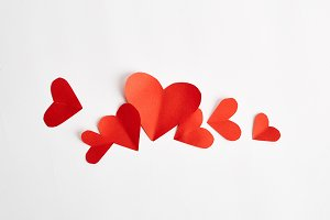 Red paper hearts isolated on white