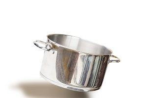 Flying empty cooking pot , isolated