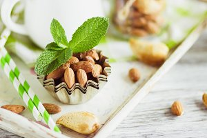 Mint leaves, almonds and jar with milk on the wooden tray