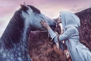 girl in the hooded cloak  with horse