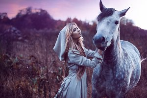 beauty blondie with horse in the fie