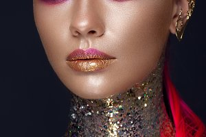 Beautiful girl with creative glitter makeup, sparkles, unusual eyebrows. Beauty is an art face.