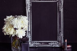Vintage photo frame and flowers