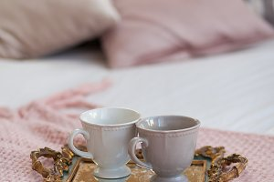 Two cups of coffee on a tray. Breakfast in bed