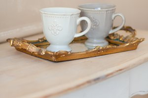 Two cups of coffee on a vintage tray