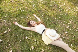 Woman lying on the grass.