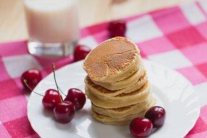 Tasty Pancake with fresh cherries on