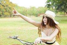 Woman sitting on the bike