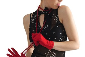 woman in red beads and gloves