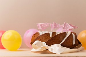 Balloons and sweet cake with ribbon