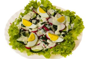 Salad with eggs isolated