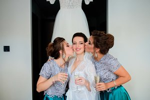 Bride and bridesmaids in blue dress