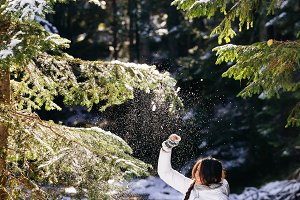 woman in snow forest