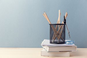 Composed cup of pencils and books