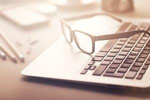 Closeup of eyeglasses on laptop