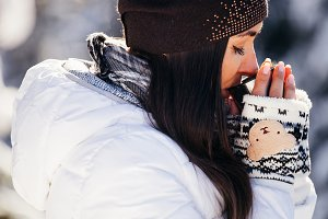 girl drinks tea in cold winter