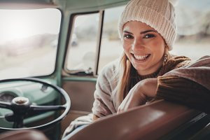 Happy woman travelling by van