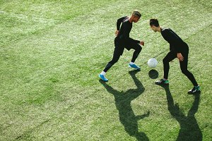 Soccer players in action on field