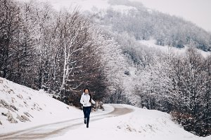 woman walk in snowy forest