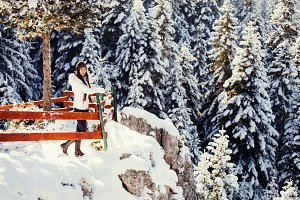 woman travel in winter forest