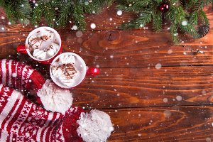 Christmas hot chocolate with marshmelow on a dark wooden background
