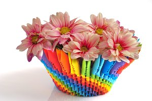 Pink daisy in origami colorful vase