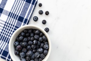 Blueberries fruit in white bowl