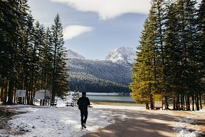 man travel to snowy mountains