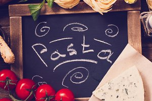 Italian food on vintage wooden plank