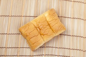Loaf of bread on wooden plate