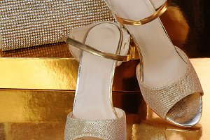 A pair of gold shoes