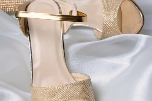 A pair of gold sandals