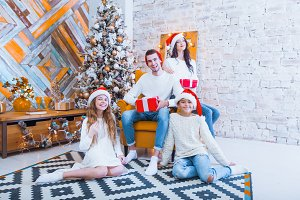 A Christmas photograph of a beautiful family with two children i