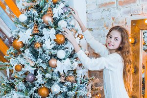 Portrait of happy girl decorating Christmas tree