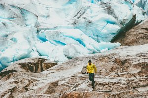 Man running at Nigardsbreen glacier