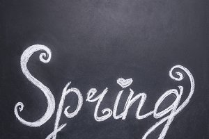 Word spring on chalkboard