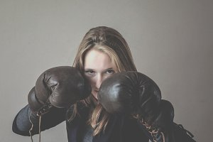 Angry girl with boxing gloves