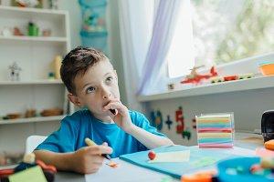 Thinking student doing his homework