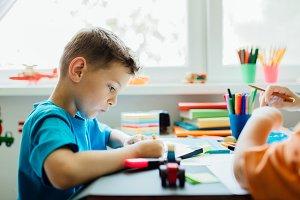 whistling student doing his homework