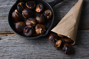 Roasted chestnuts in Pan and a Paper